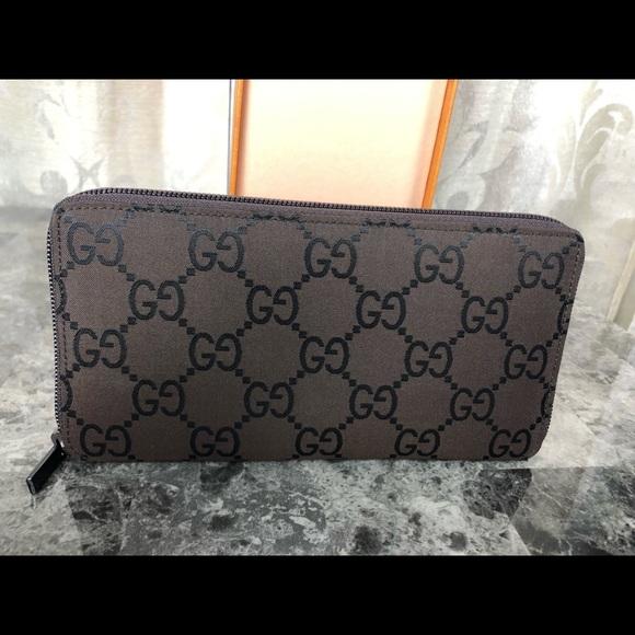 Gucci Handbags - Gucci Signature Zippy Wallet